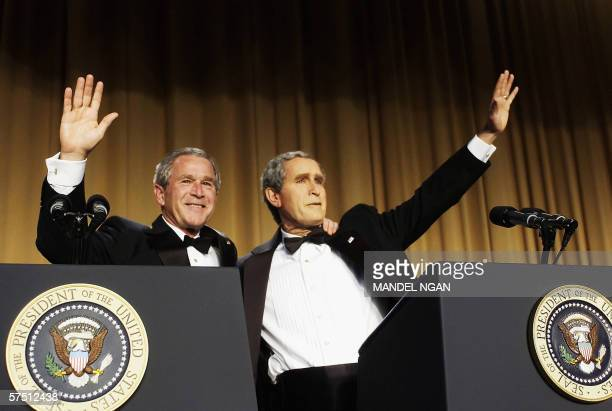 US President George W Bush waves with comedian Steve Bridges who is impersonating him at the White House Correspondents' Association Dinner 29 April...