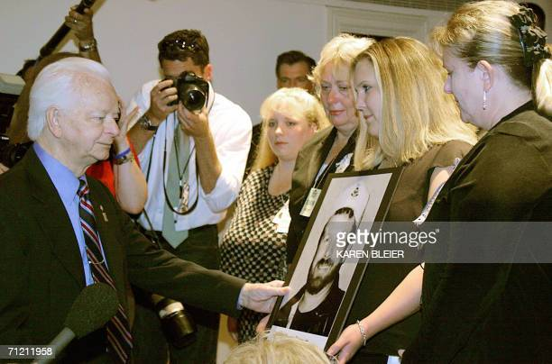 US Sen Rober Byrd greets family members of Sago Mine accident victim Marty Bennett niece Allison Sharp holding a picture of Bennett as daughter Bobby...