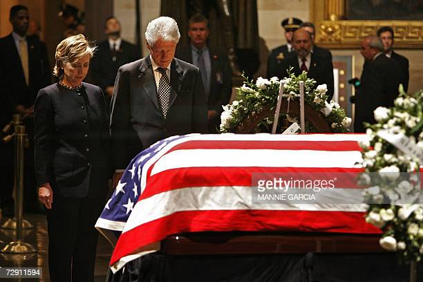 US Senator Hillary Clinton and former US president Bill Clinton pay their respects before the casket of former US president Gerald R Ford as he lies...