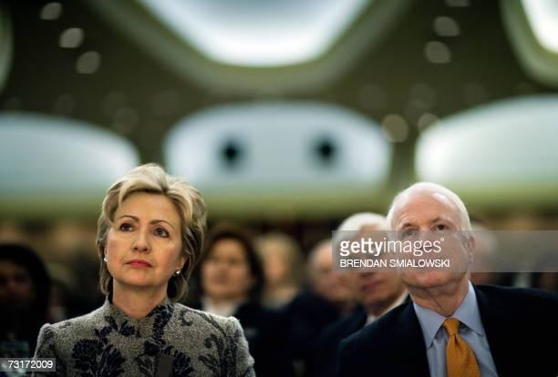 US Senator Hillary Rodham Clinton and Senator John McCain listen to President George W Bush speak during the National Prayer Breakfast 01 February...