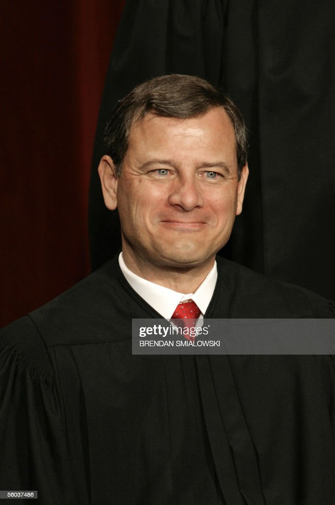US Supreme Court Chief Justice John Roberts Jr. sits for a class photo at the Supreme Court 31 October 2005 in Washington. The Justices sat for their picture for Chief Justice Roberts's first class photo. AFP PHOTO/Brendan SMIALOWSKI