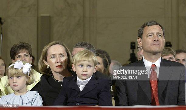 US Supreme Court Chief Justice nominee John Roberts sits with his family in a hearing room on Capitol Hill in Washington DC as he awaits the start of...