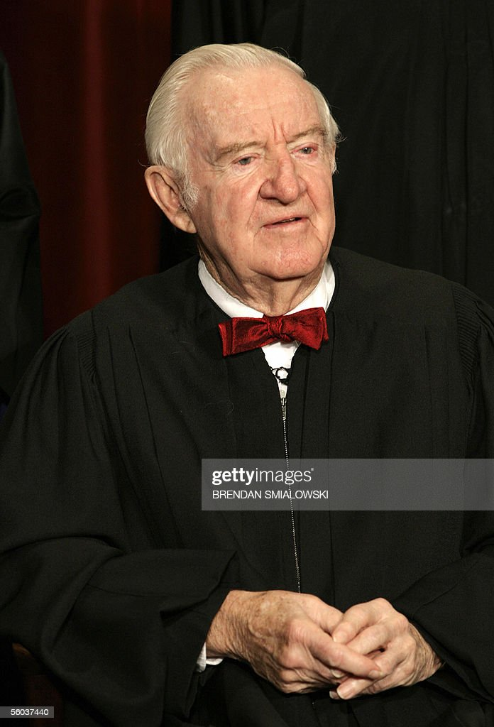 US Supreme Court Justice John Paul Stevens sits for a class photo at the Supreme Court 31 October 2005 in Washington. The Justices sat for their picture for Chief Justice John Roberts's first class photo. AFP PHOTO/Brendan SMIALOWSKI