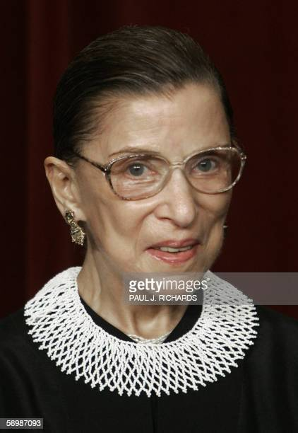 US Supreme Court Justice Ruth Bader Ginsburg looks at the camera as the justices pose for their class photo 03 March 2006 inside the Supreme Court in...