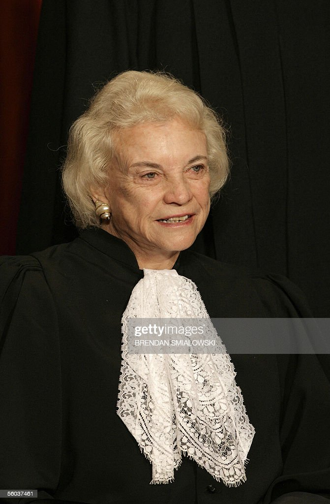 US Supreme Court Justice Sandra Day O'Connor sits for a class photo at the Supreme Court 31 October 2005 in Washington. The Justices sat for their picture for Chief Justice Roberts's first class photo. AFP PHOTO/Brendan SMIALOWSKI