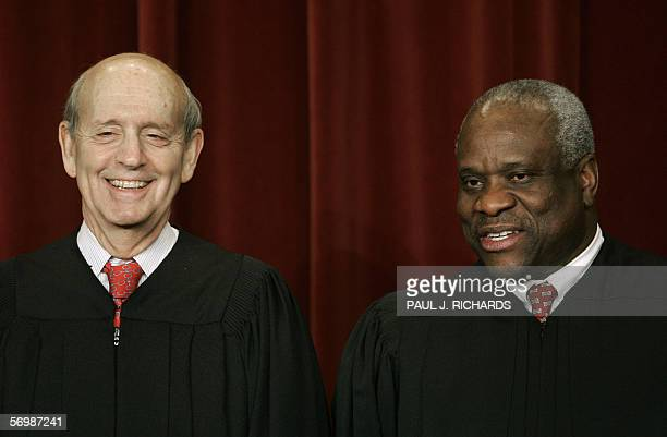 Washington, UNITED STATES: US Supreme Court justices Stephen Breyer and Clarence Thomas smile as the justices pose for their class photo 03 March...