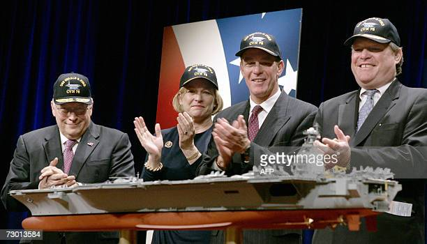 US Vice President Dick Cheney applauds a model of the new US Navy aircraft carrier the USS Gerald R Ford alongside former President Ford's daughter...