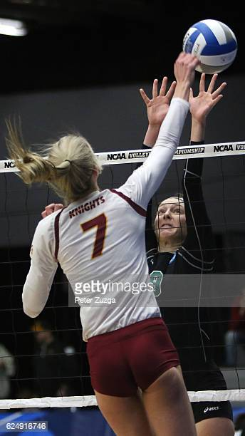 Washington University's Rexi Sheredy attempts to block a ball hit by Calvin College's Sarah DeVries during the Division III Women's Volleyball...
