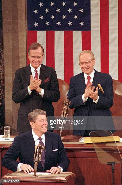 Vice President Geroge Bush and Speaker of the House Jim Wright applaud as President Reagan prepares to make his State of the Union address before a...