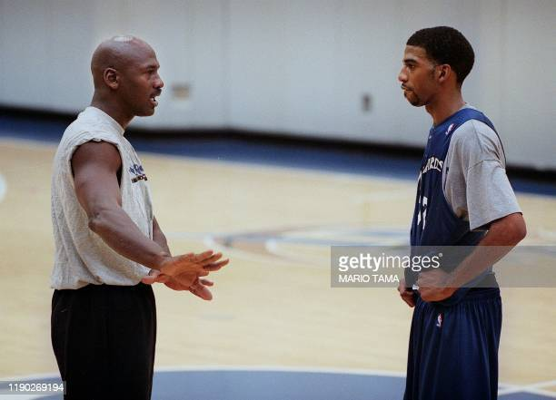 Washington Wizard basketball coowner Michael Jordan gives instruction to Wizard Richard Hamilton during a round of practice at the MCI Center 31...