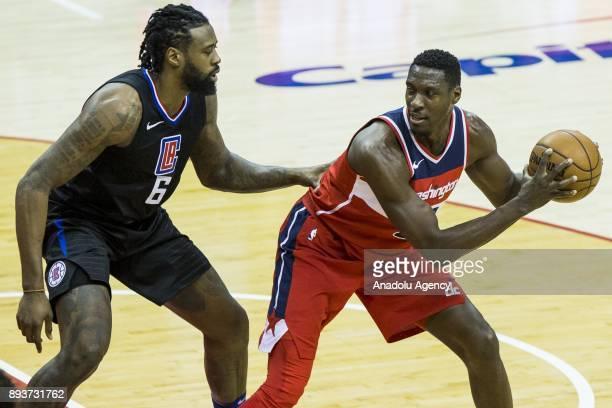 Washington Wizard Ian Mahinmi keeps the ball away from Los Angeles Clipper DeAndre Jordan at the Capital One Arena in Washington USA on December 15...