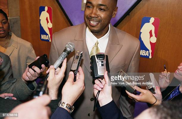 Washington Wizards assistant general manager Rod Higgins is beseiged by news media after his team won the first pick in the draft during the 2001 NBA...
