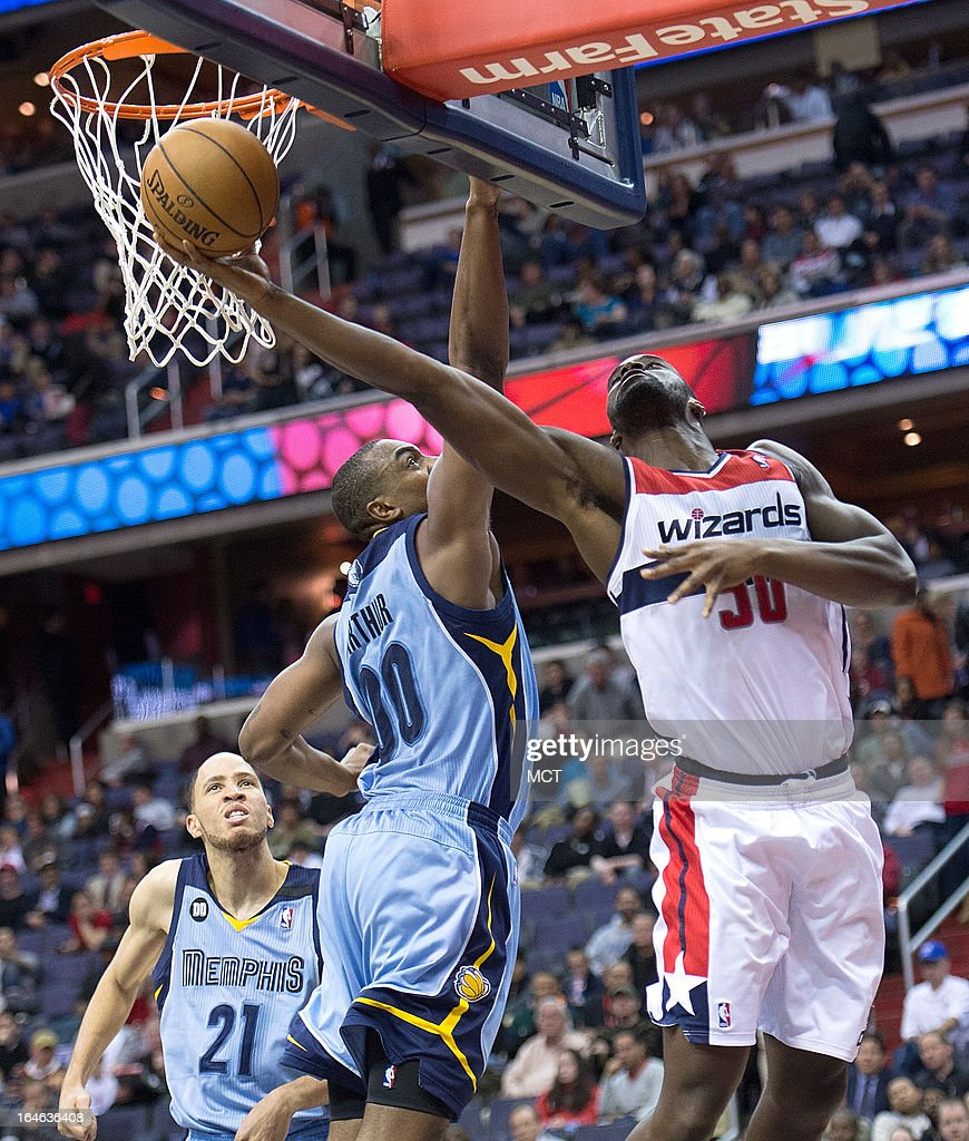 Washington Wizards center Emeka Okafor (50) shoots around Memphis Grizzlies power forward Darrell Arthur (00) during the second half of their game played at the Verizon Center in Washington, D.C., Monday, March 25, 2013. Washington defeated Memphis 107-94.