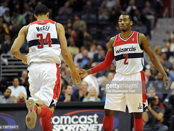 Washington Wizards center JaVale McGee gets high five from Washington Wizards point guard John Wall after he two combined for a basket during the...