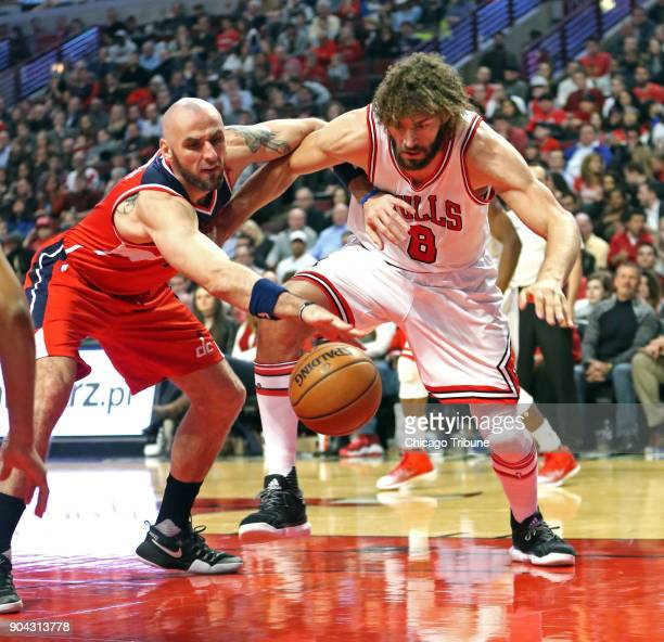 Washington Wizards center Marcin Gortat and Chicago Bulls center Robin Lopez go after a lose ball during the first half on Wednesday Dec 21 2016 at...