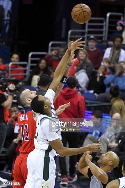 Washington Wizards center Marcin Gortat in action against Milwaukee Bucks forward John Henson on January 15 2018 at the Capital One Arena in...