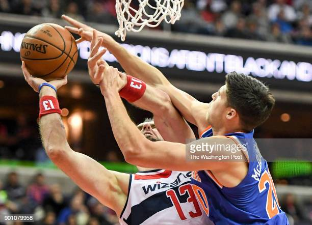 Washington Wizards center Marcin Gortat is fouled by New York Knicks forward Doug McDermott during first half action at Capital One Arena