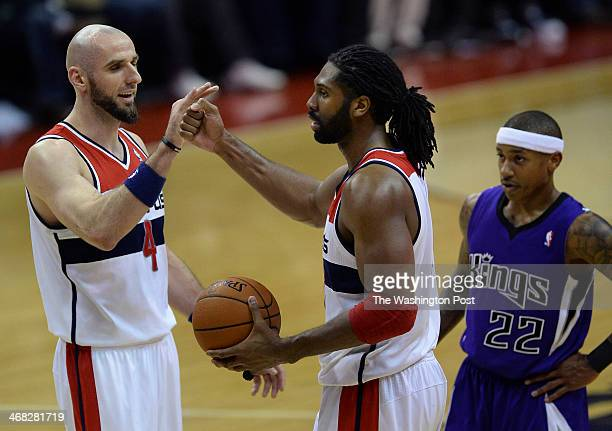 Washington Wizards center Marcin Gortat left congratulates Washington Wizards power forward Nene Hilario after he was fouled during the second half...