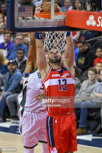 Washington Wizards center Marcin Gortat scores against Milwaukee Bucks forward Giannis Antetokounmpo on January 15 2018 at the Capital One Arena in...