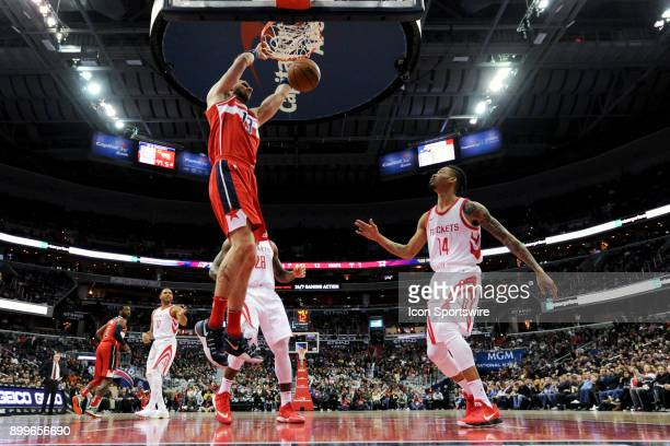 Washington Wizards center Marcin Gortat scores in the first half against Houston Rockets guard Gerald Green on December 29 2017 at the Capital One...