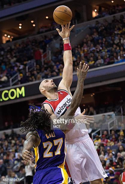 Washington Wizards center Marcin Gortat scores over Los Angeles Lakers center Jordan Hill during the second half of their game played at the Verizon...