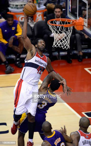 Washington Wizards center Nene gets fouled by Los Angeles Lakers small forward Devin Ebanks as he goes up for a shot in the fourth quarter at the...