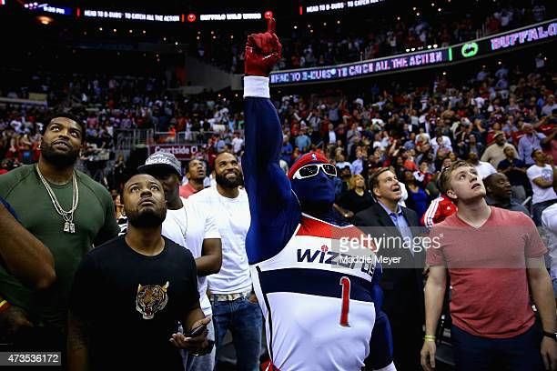 Washington Wizards fans watch a replay of Paul Pierce of the Washington Wizards shooting a three point shot at the end of the fourth quarter against...
