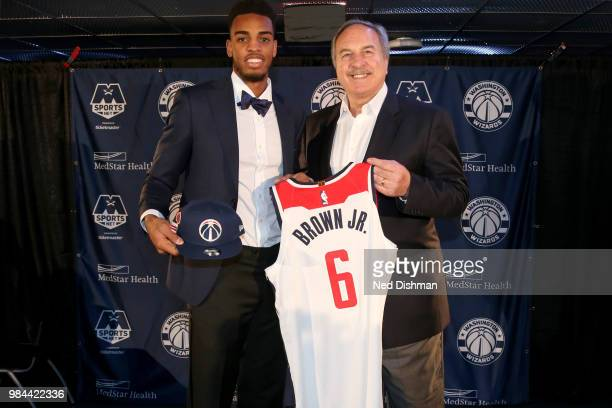 Washington Wizards firstround draft pick Troy Brown Jr poses for a photo with Ernie Grunfeld during a press conference on June 25 2018 at Capital One...