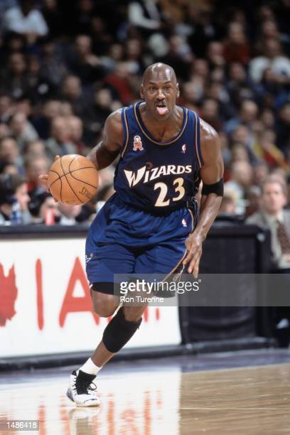 Washington Wizards forward Michael Jordan dribbles the ball during the NBA game against the Toronto Raptors at the Air Canada Centre in Toronto,...