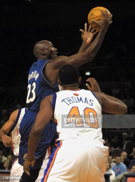 Washington Wizards' forward Michael Jordan scores his first basket in his first game since returning to the NBA over the New York Knicks' Kurt Thomas...