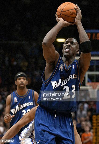 Washington Wizards forward Michael Jordan shoots a wide open gamewinning buzzerbeater in front of Cleveland Cavaliers guard Andre Miller as Wizards...