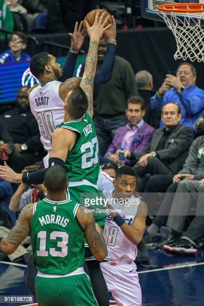 Washington Wizards forward Mike Scott scores and is fouled by Boston Celtics forward Daniel Theis on February 8 2018 at the Capital One Arena in...