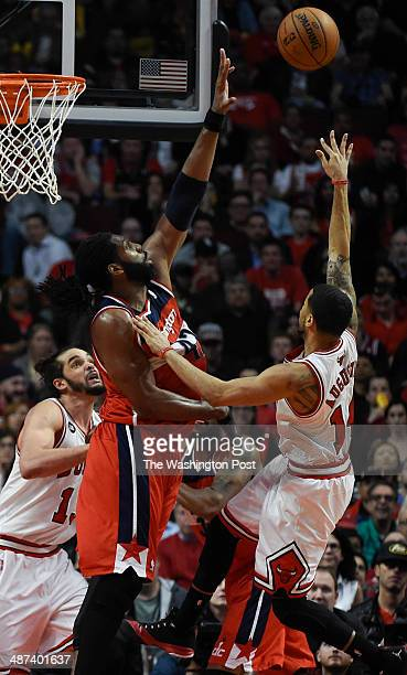 Washington Wizards forward Nene Hilario blocks a shot by Chicago Bulls guard DJ Augustin during the second half of game five of the NBA playoffs...