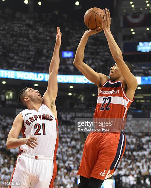 Washington Wizards forward Otto Porter Jr fires a shot over Toronto Raptors guard Greivis Vasquez during game one action on April 18 2015 in Toronto...