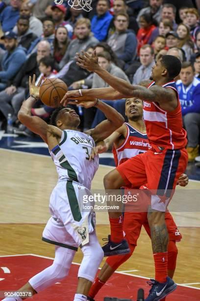 Washington Wizards forward Otto Porter Jr fouls Milwaukee Bucks forward Giannis Antetokounmpo as guard Bradley Beal comes in on defense on January 15...