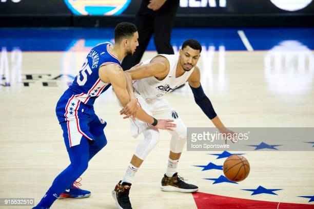 Washington Wizards Forward Otto Porter Jr shields the ball from Philadelphia 76ers Guard Ben Simmons in the second half during the game between the...