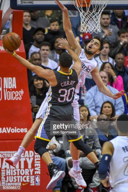 Washington Wizards forward Tomas Satoransky defends Golden State Warriors guard Stephen Curry on February 28 2018 at the Capital One Arena in...