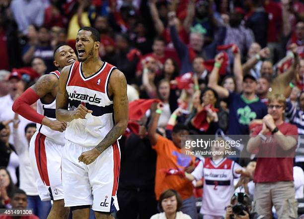 Washington Wizards forward Trevor Ariza celebrates after a dunk in the fourth quarter of game four of the NBA play-offs between the Washington...