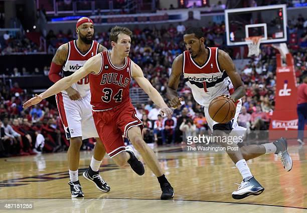 Washington Wizards forward Trevor Ariza drives past Chicago Bulls forward Mike Dunleavy as Washington Wizards forward Drew Gooden looks on in the...
