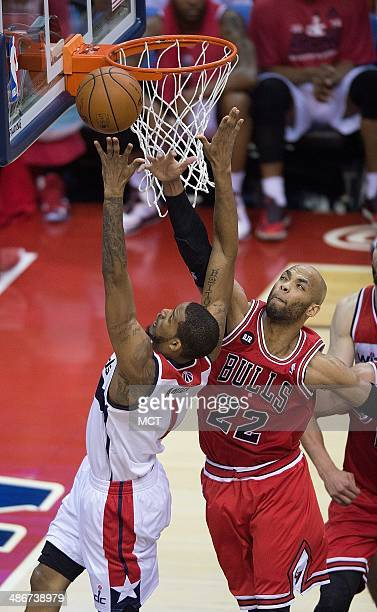 Washington Wizards forward Trevor Ariza scores against Chicago Bulls forward Taj Gibson during the first half of their first round playoff game...