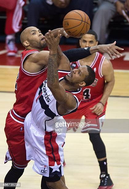 Washington Wizards forward Trevor Ariza shoots against Chicago Bulls forward Taj Gibson during the first half of their first round playoff game...