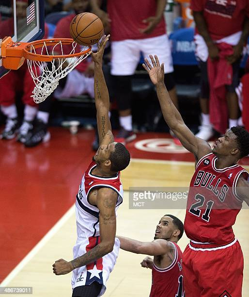 Washington Wizards forward Trevor Ariza taps in a rebound for a score in front of Chicago Bulls guard Jimmy Butler during the first half of their...
