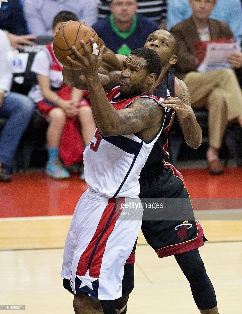 Washington Wizards forward Trevor Booker (35) is fouled by Miami Heat forward James Jones (22) during the second half of their game played at the Verizon Center in Washington, Monday, Apr. 14, 2014. Washington defeated 114-93.