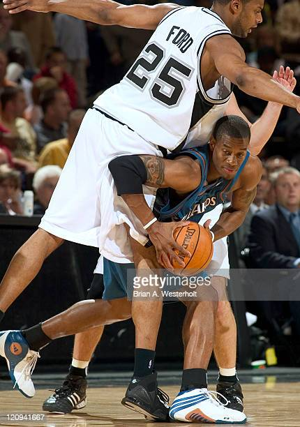 Washington Wizards guard Antonio Daniels is fouled by San Antonio forward Sharrod Ford during preseason action at the LJVM Coliseum in Winston-Salem,...