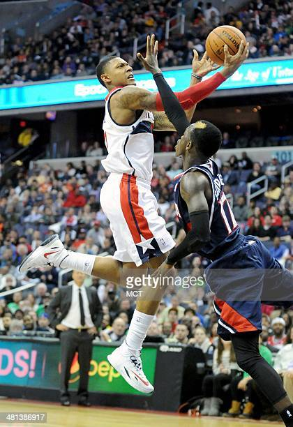 Washington Wizards guard Bradley Beal drives to the basket by Atlanta Hawks guard Dennis Schroder during the second half at the Verizon Center in...