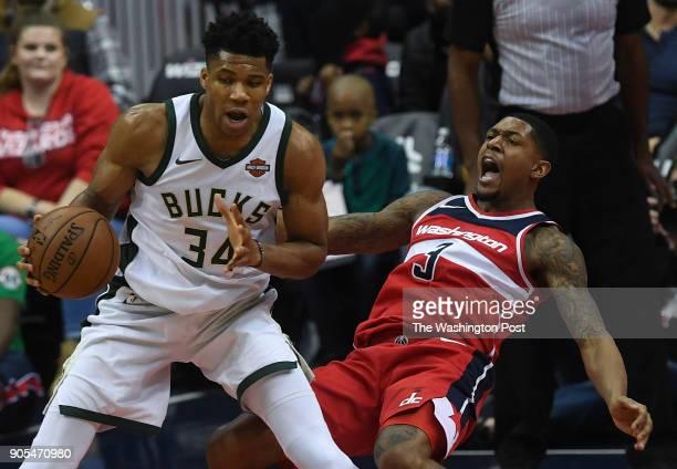 WASHINGTON DC JANUARY Washington Wizards guard Bradley Beal falls back after getting bumped by Milwaukee Bucks forward Giannis Antetokounmpo during...