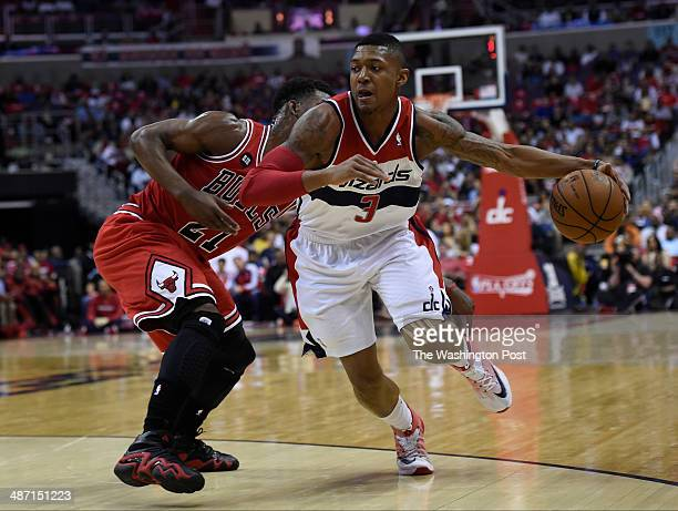 Washington Wizards guard Bradley Beal gets past Chicago Bulls guard Jimmy Butler in the first quarter of game four of the NBA playoffs between the...