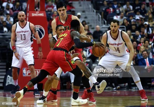 WASHINGTON DC APRIL Washington Wizards guard Bradley Beal kicks his leg as he tries to stop Atlanta Hawks guard Dennis Schroder during the first half...