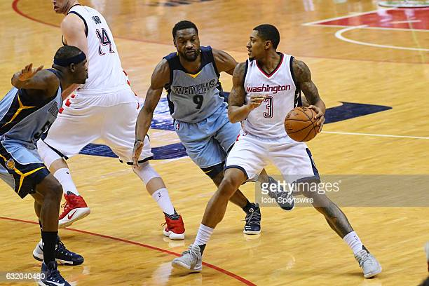 Washington Wizards guard Bradley Beal moves the ball in the first half against Memphis Grizzlies guard Tony Allen and forward Zach Randolph on...