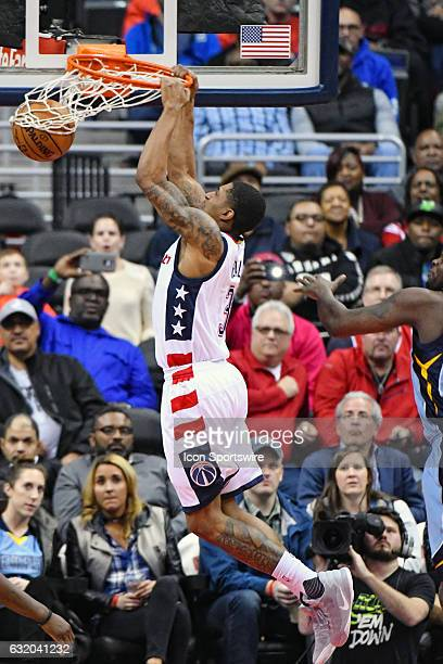 Washington Wizards guard Bradley Beal scores in the second half against Memphis Grizzlies forward Zach Randolph on January 18 at the Verizon Center...